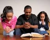 Praying father with Children